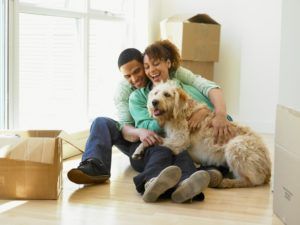 New home for pets Couple sitting with their dog