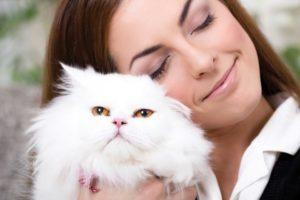 Lady holding White Cat