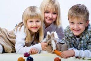 Pet parent kids and rabbit